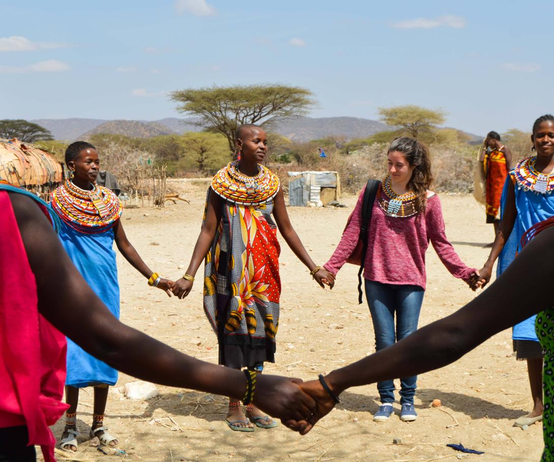 Projects Abroad volunteers learning a traditional dance to welcome them to the Samburu village during their gap year in Kenya.